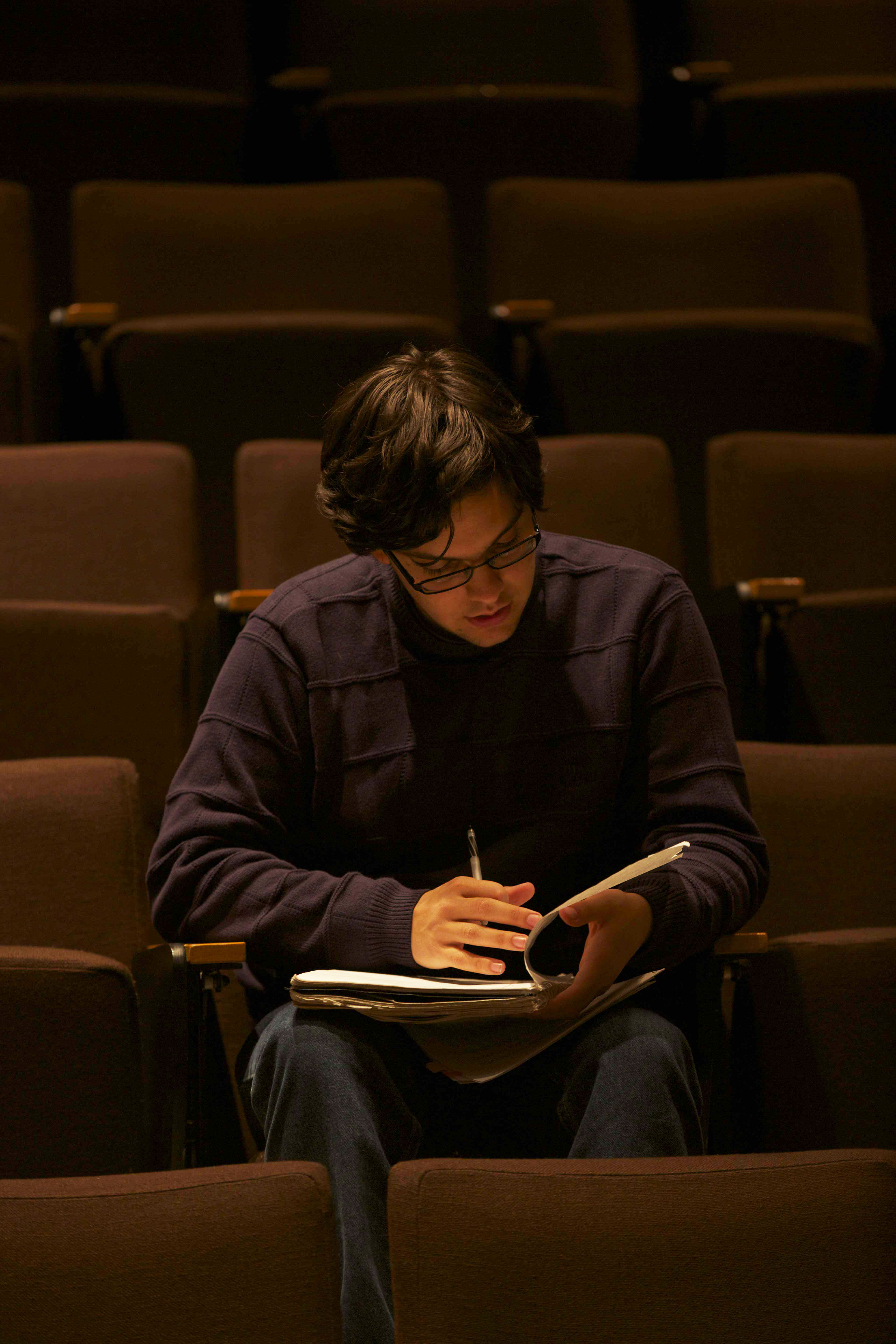 Nate Vader goes over his notes in an auditorium