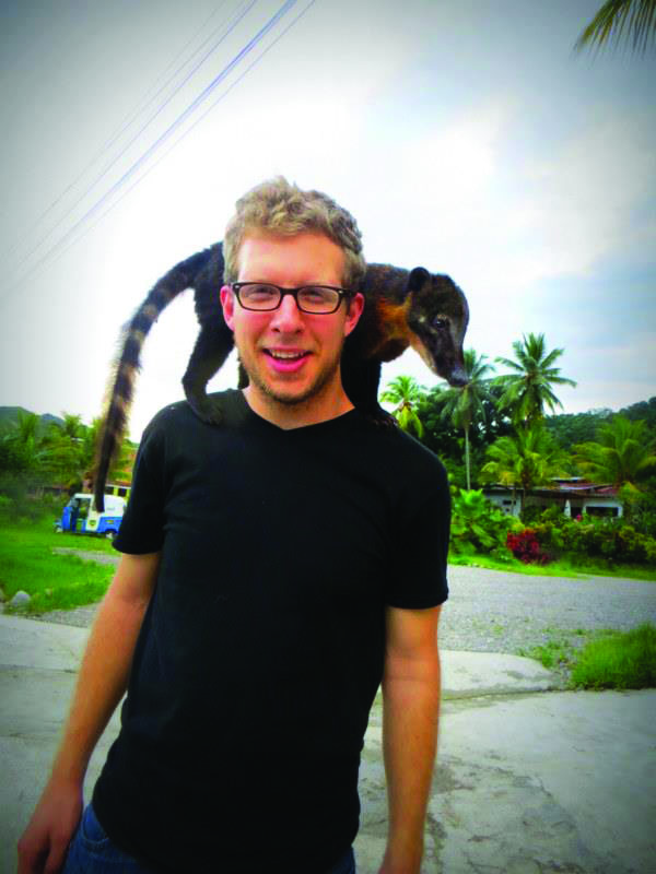 Hans Weaver with a lemur on his shoulders in Peru