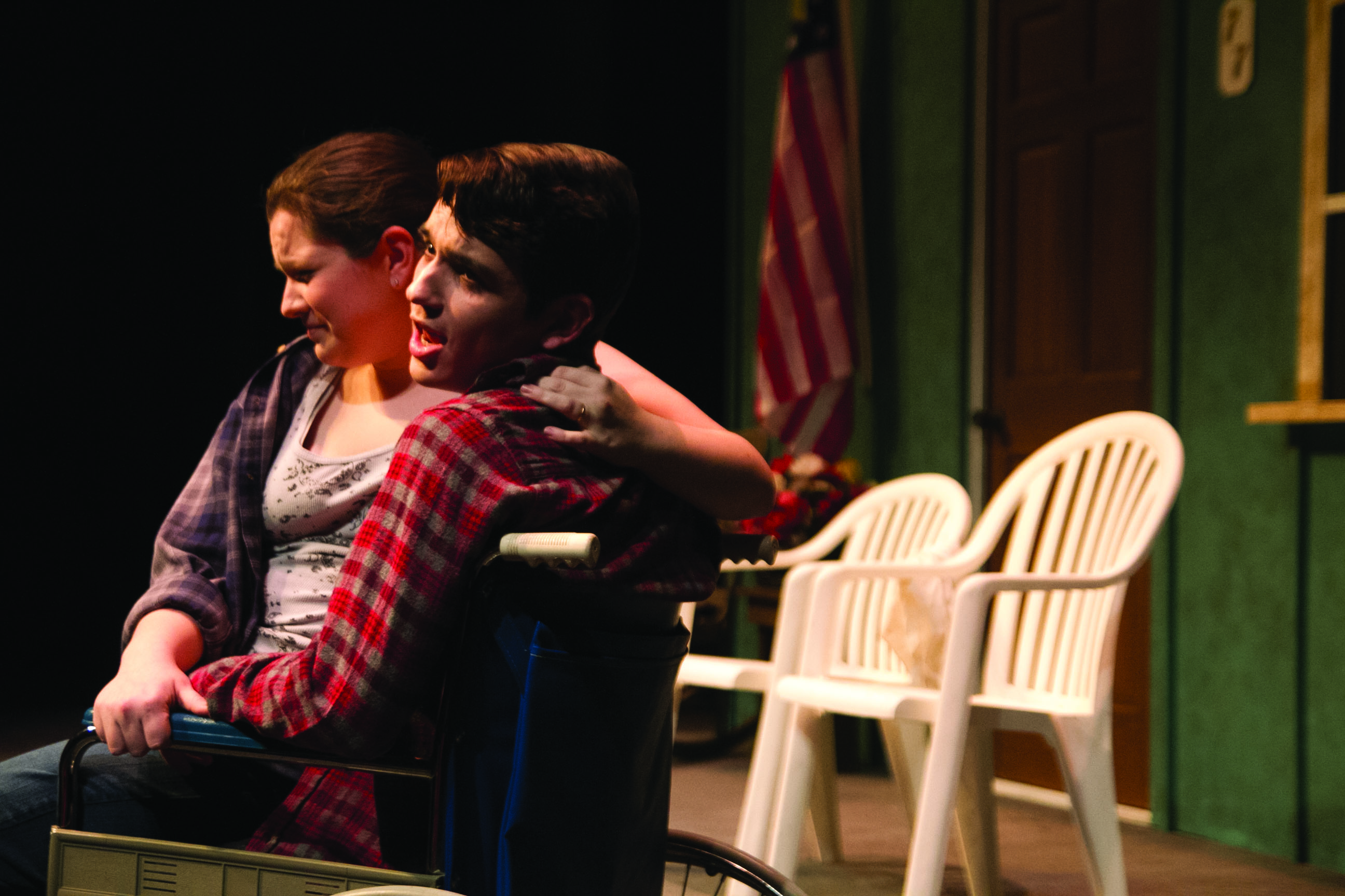 Two student actors perform on the Umble Center stage in the winter one acts