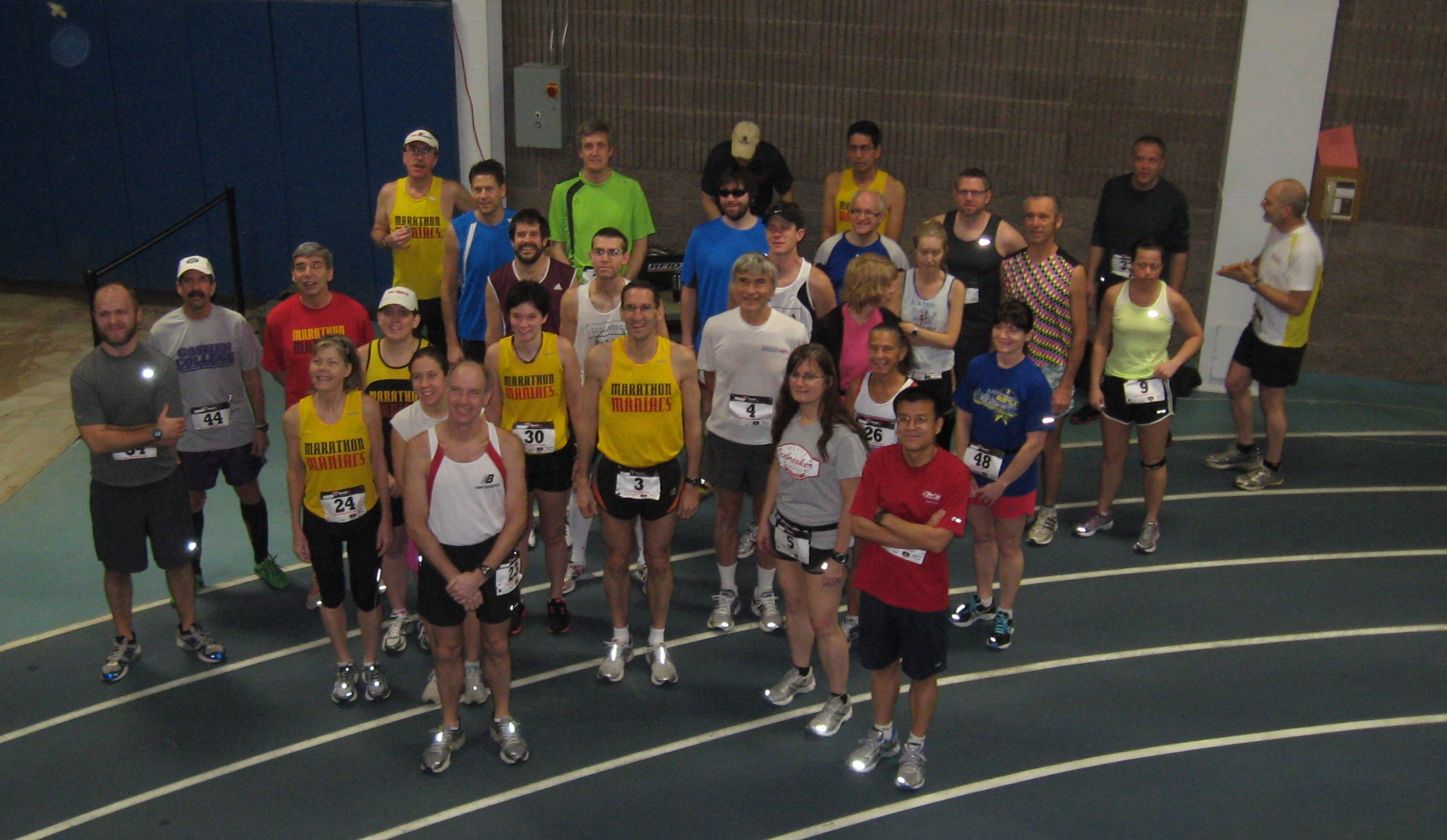 Runners in the Maple Leaf Indoor Marathon group together for a picture
