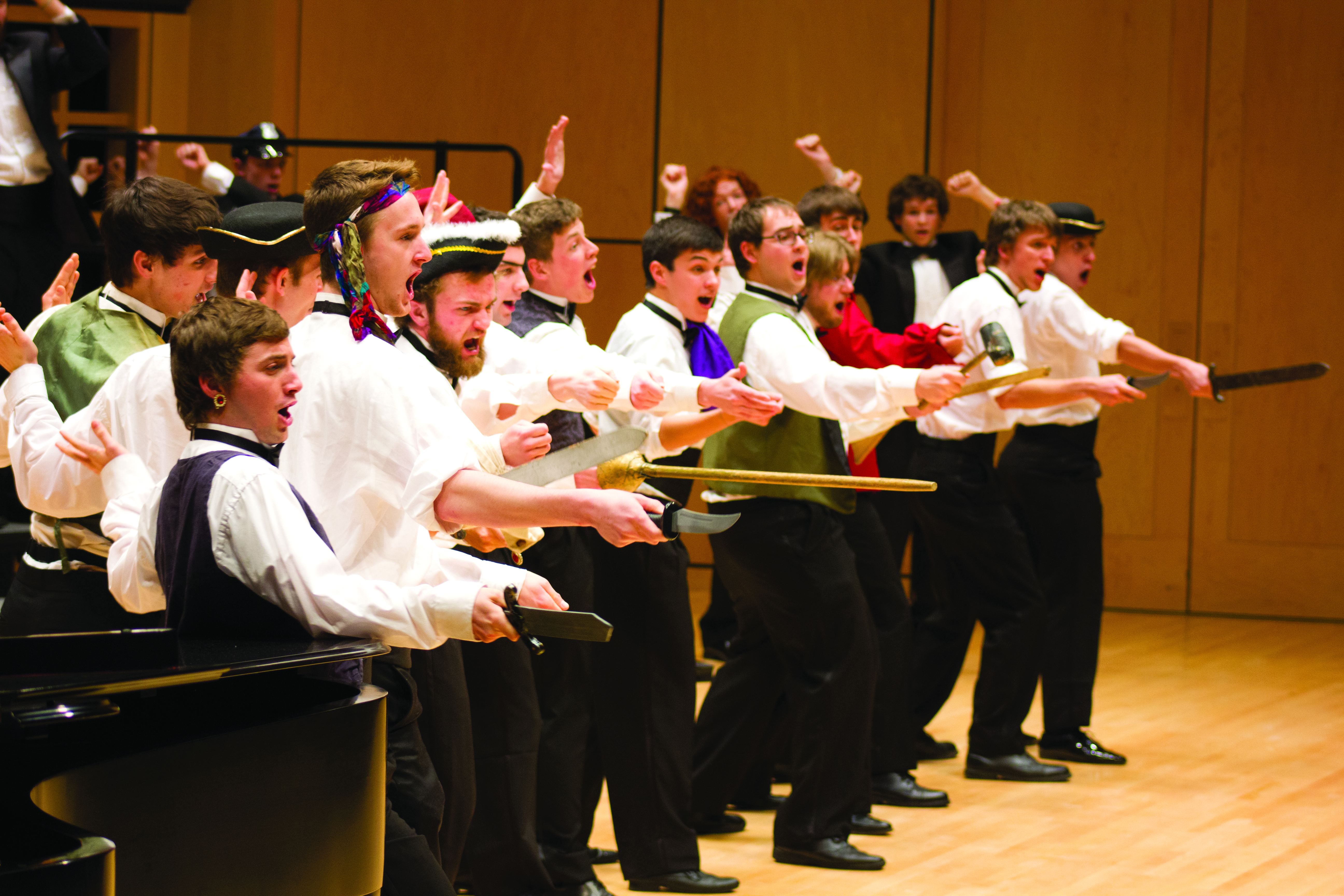 Members of the Goshen College choirs perform an opera number with colorful props and accessories