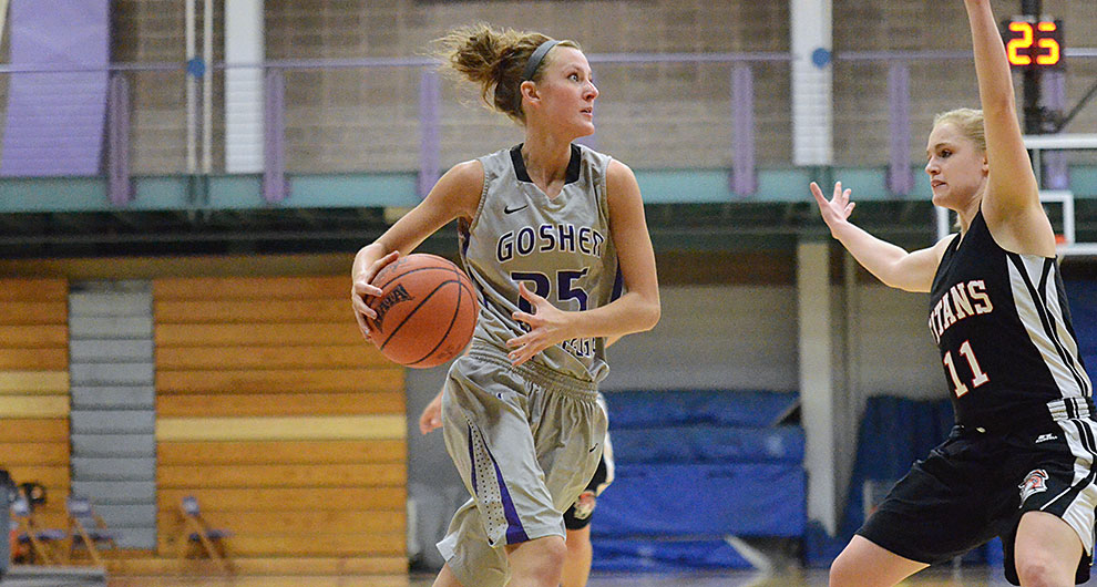 A player on the Goshen women's basketball team prepares to shoot the ball over an opposing player