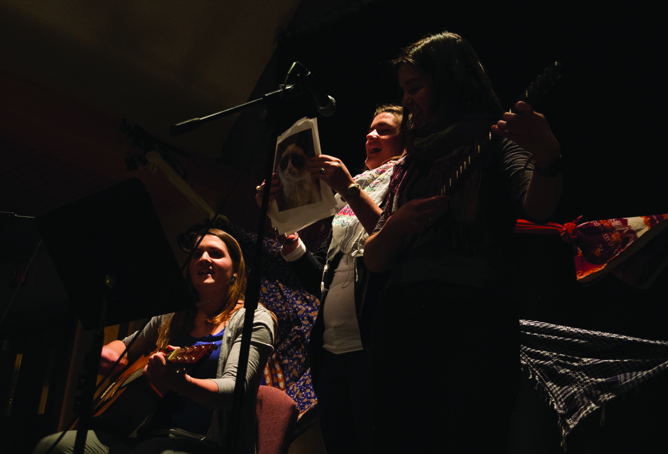 Students sing and play guitar at Chocolate House