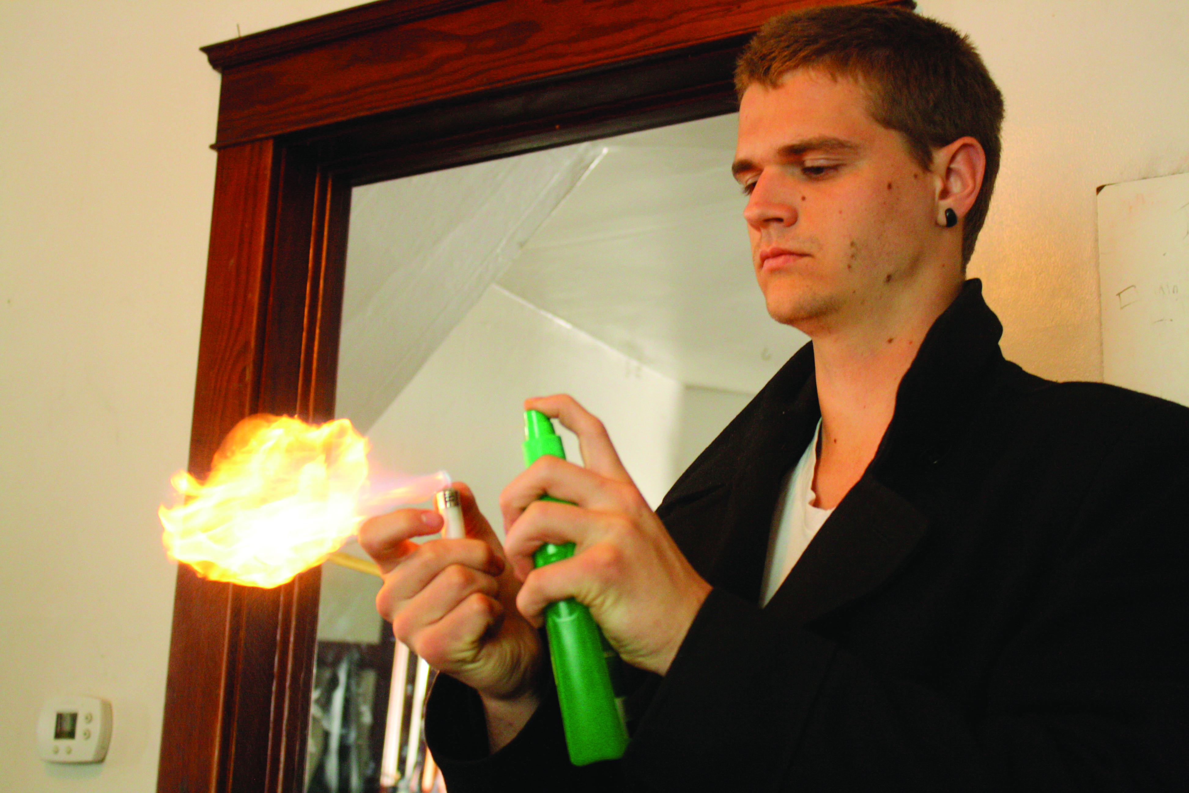 Brian O'Leary holds a burning object