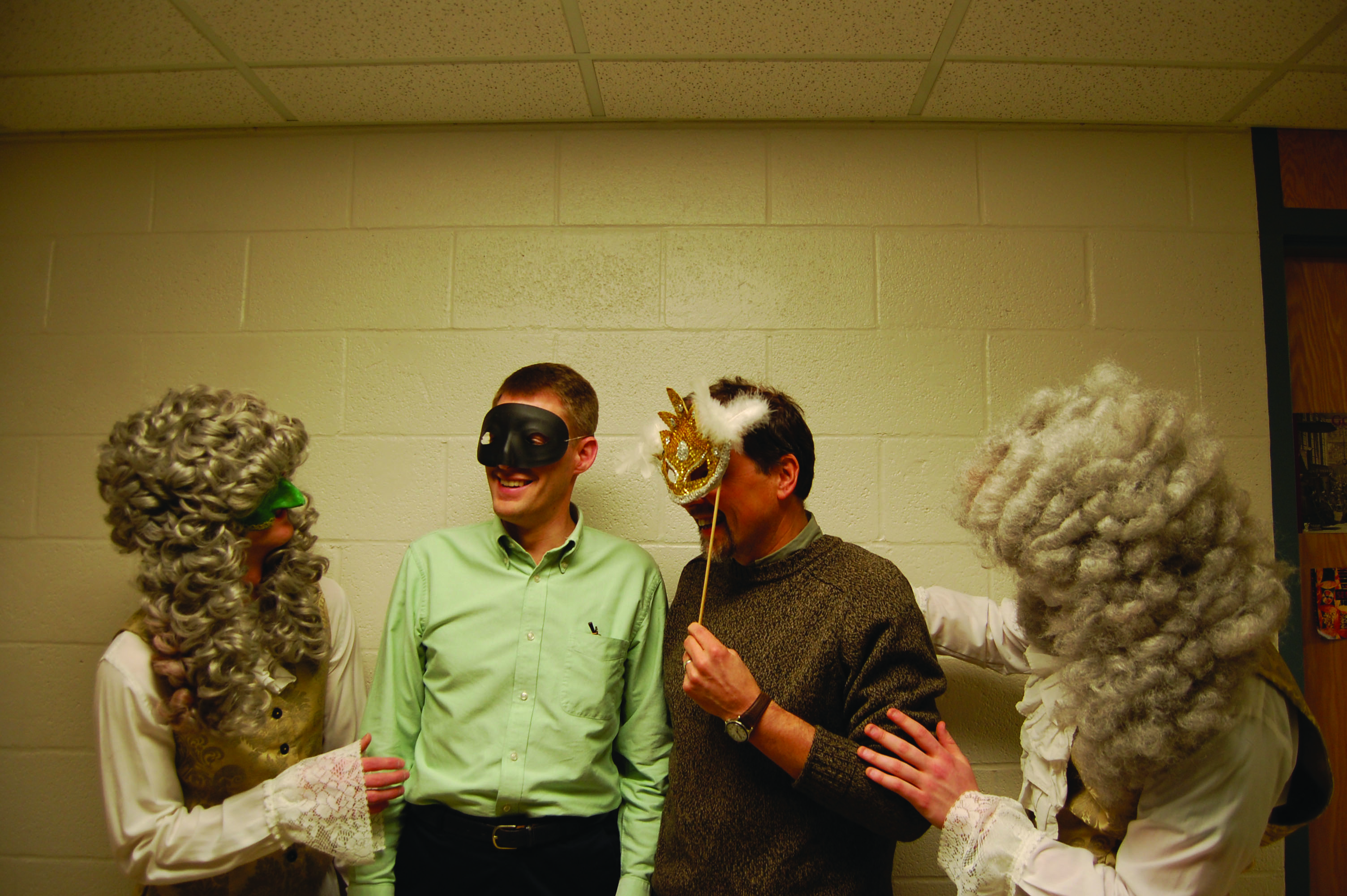 Students wear masks and wigs for the Masquerade Ball