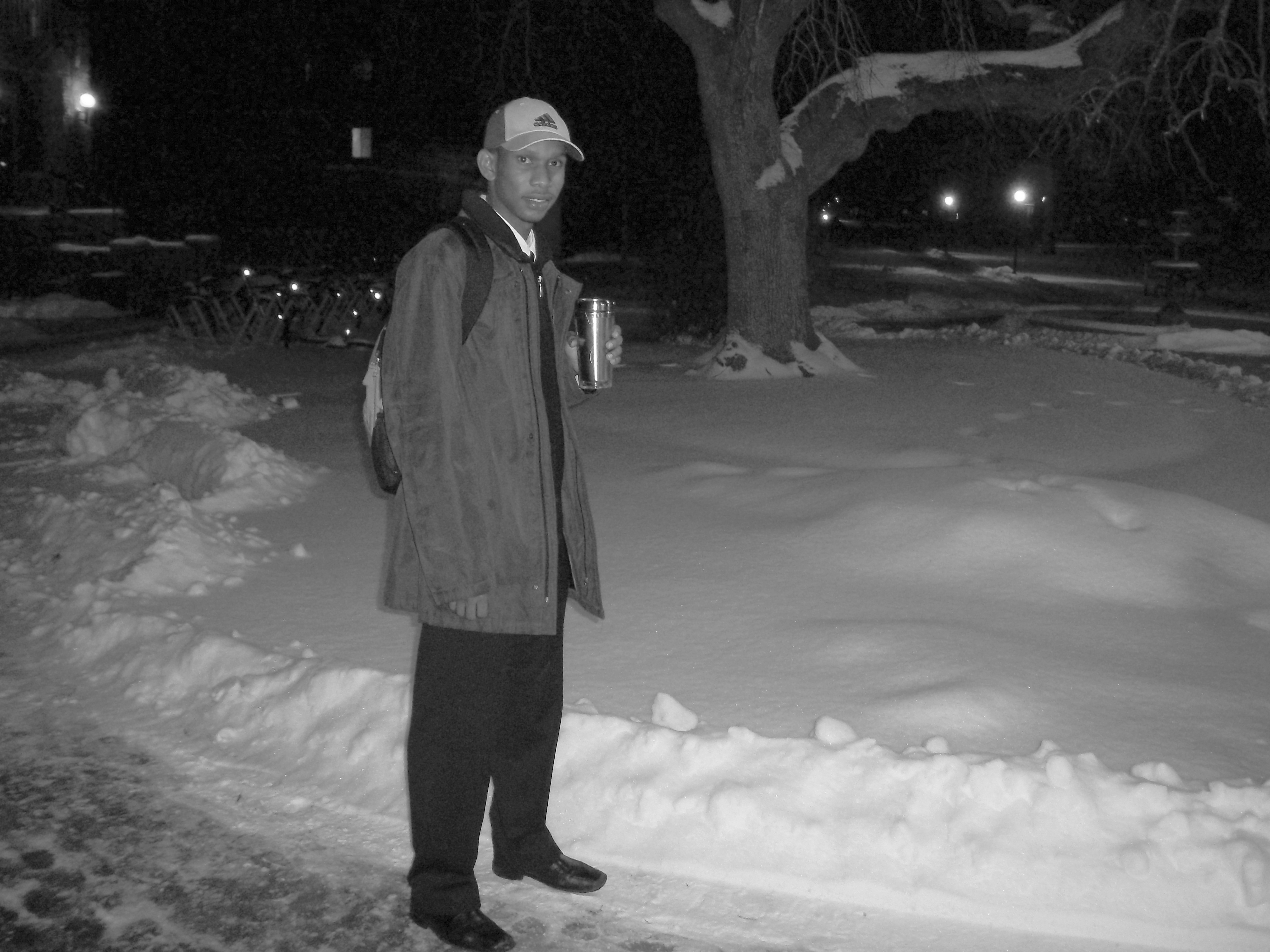 Mohamed Yarba Meissara stands on a snow-plowed path