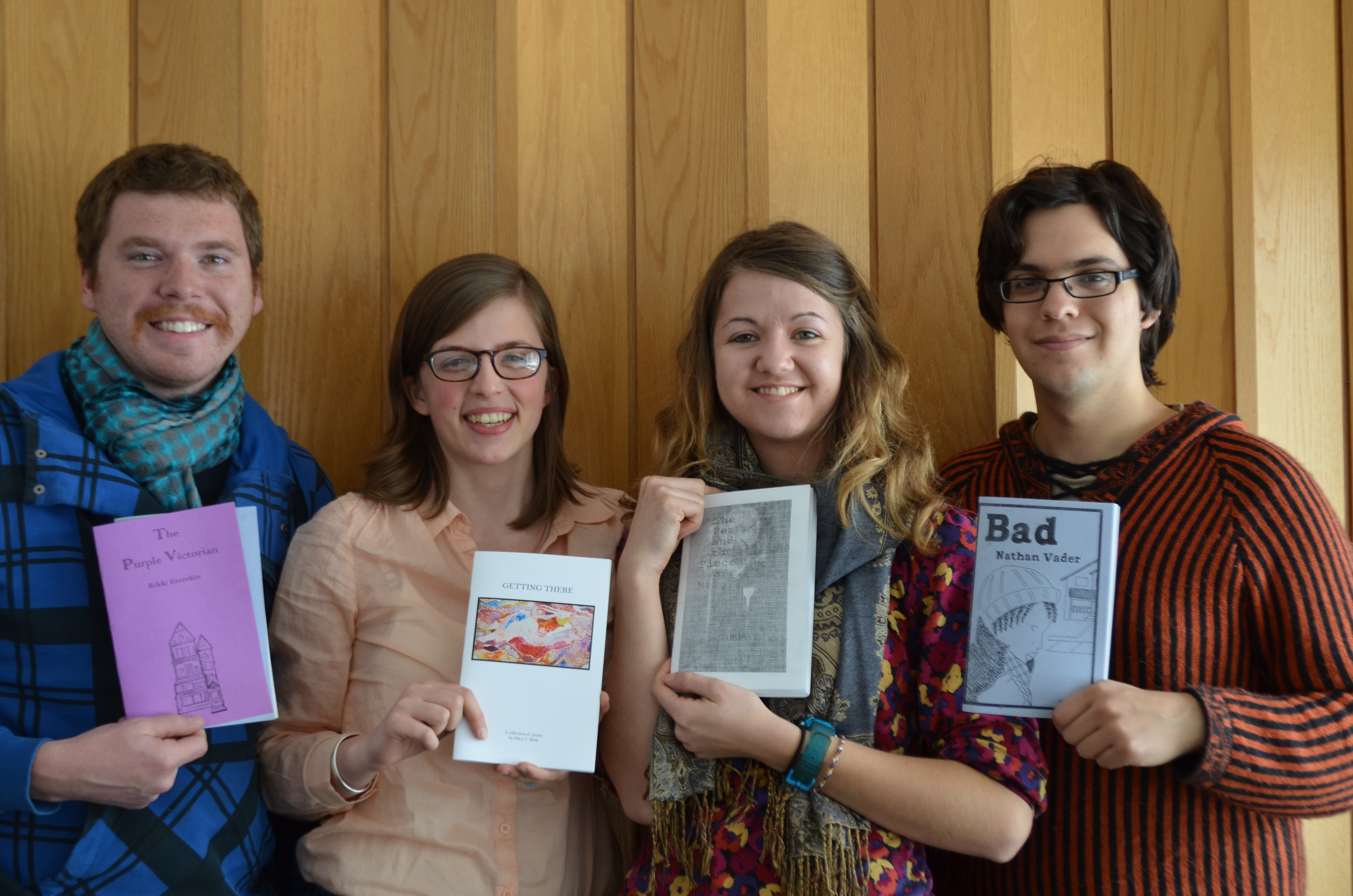 Students pose with their pinchpenny press books