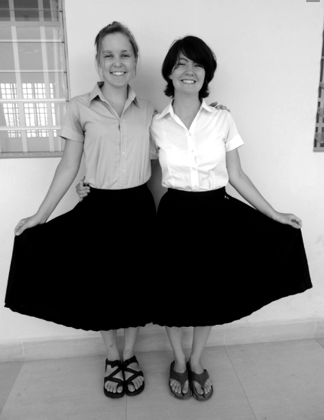 Carina Zehr and another student show off their long skirts in Cambodia
