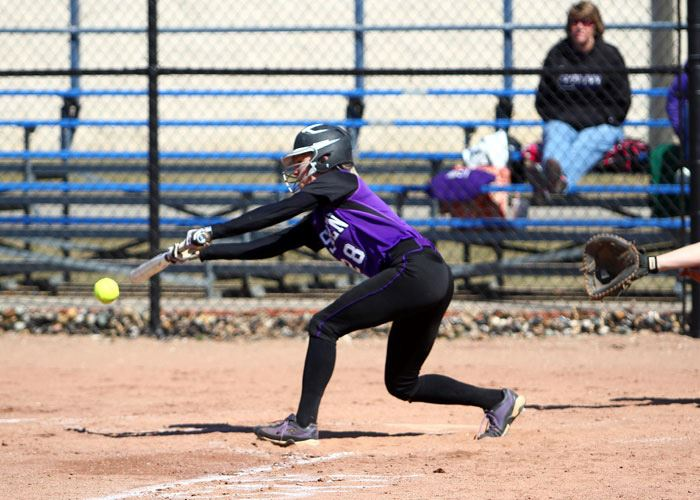 A player on the Goshen softball team hits the ball during a game