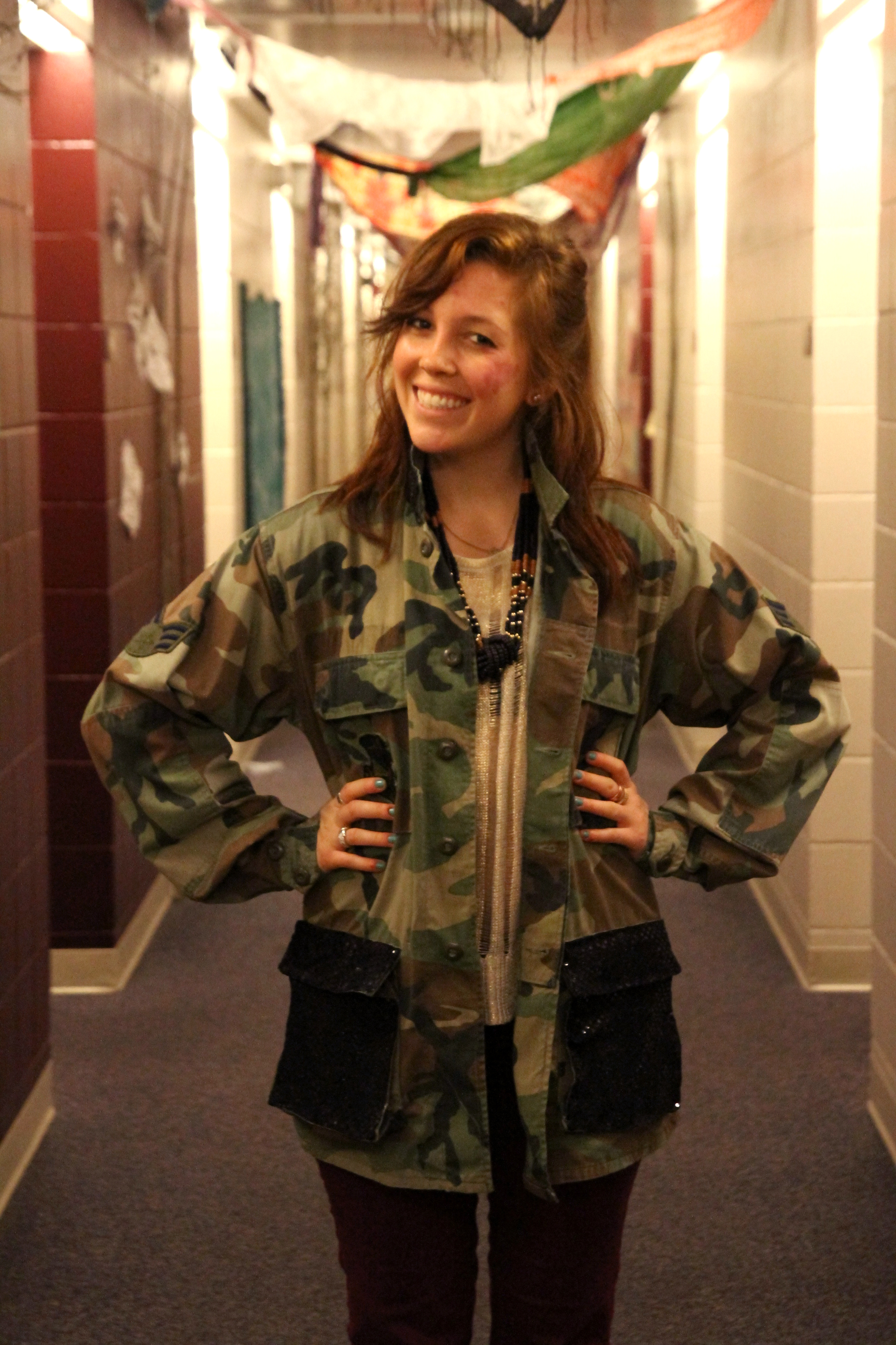 Rachel Smucker wearing her upcycled army jacket in a residence hall