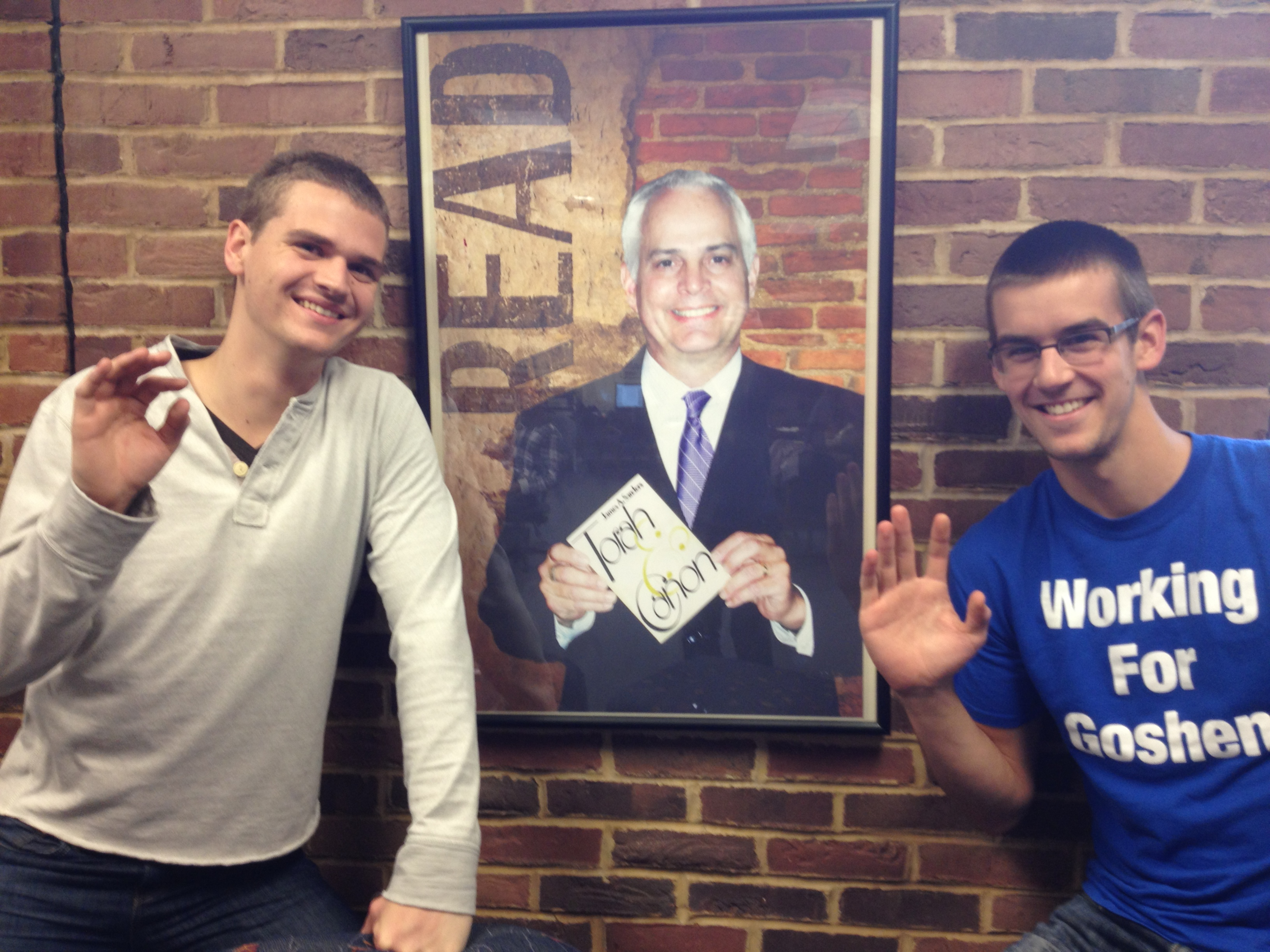 Brian O'Leary and John Miller pose with a picture of President Jim Brenneman