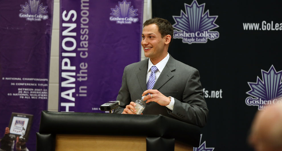 New basketball coach Neal Young answers questions at a press conference