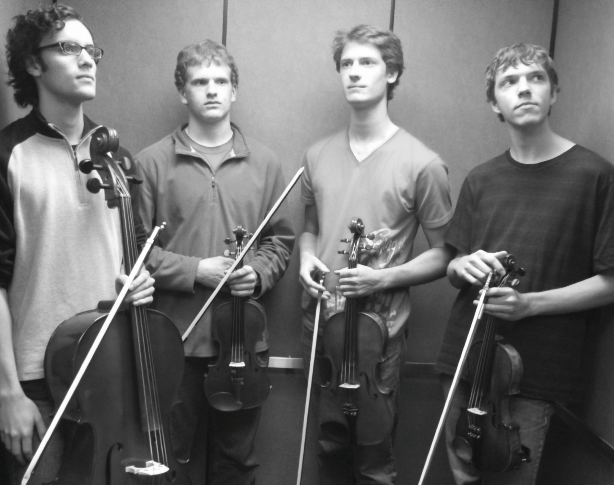 The Kool Cats Quartet bring their instruments into the Kratz elevator for a performance