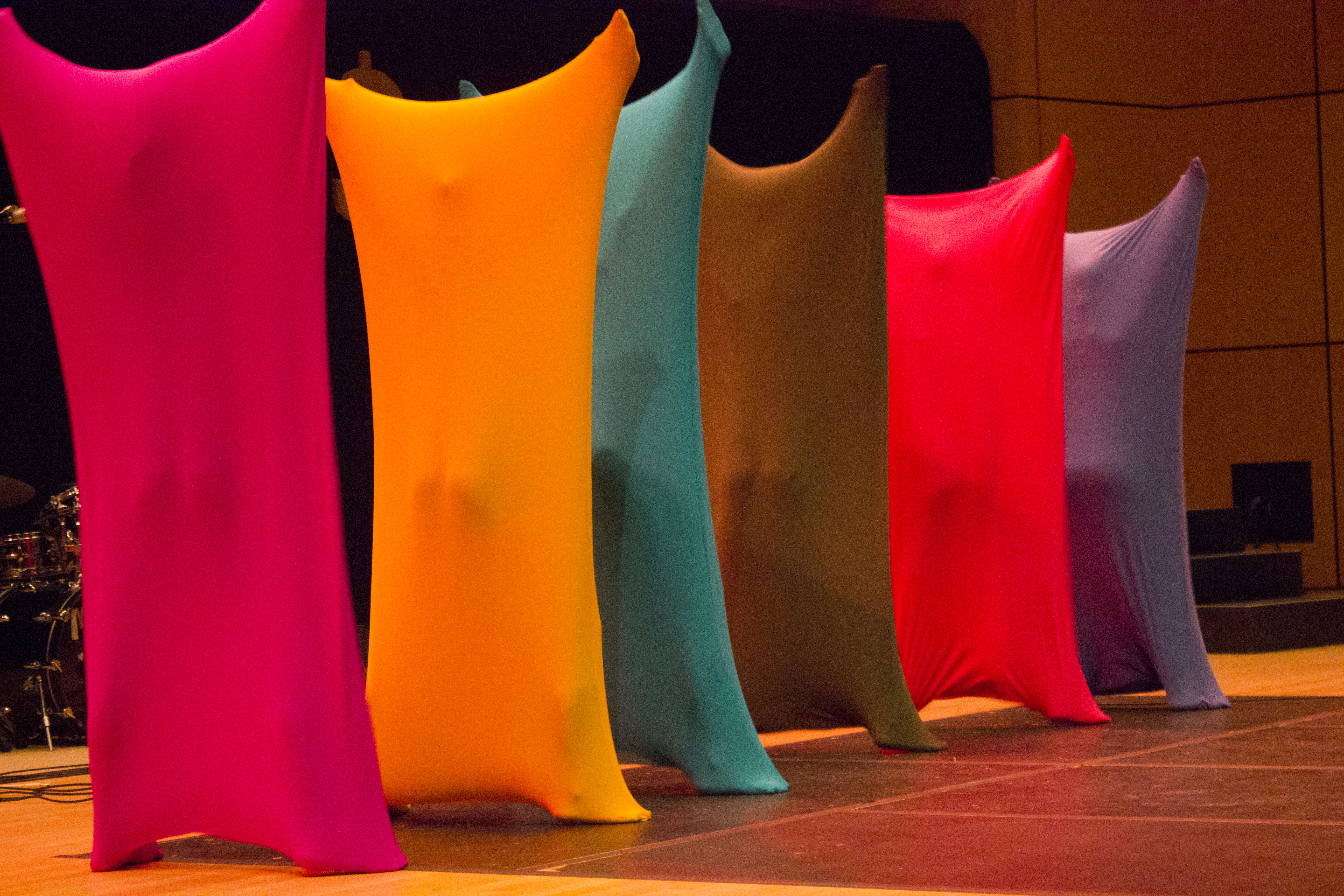 """Six Goshen College women suit up in brightly colored bags to perform as the """"Bag Ladies"""" at Kick-Off"""