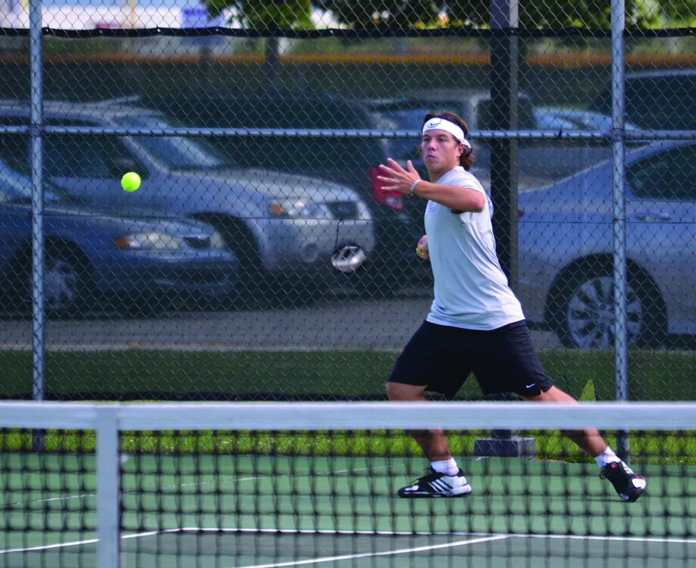 Balazs Piroit prepares to hit the ball during a tennis match