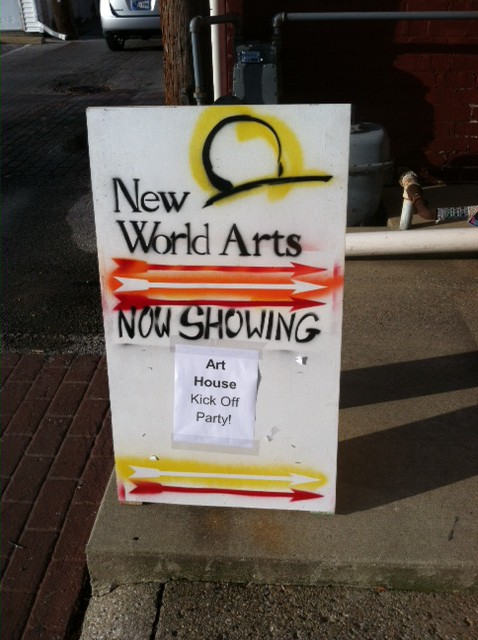 """A sign reading: """"New World Arts: Now Showing, Art House Kick Off Party"""""""