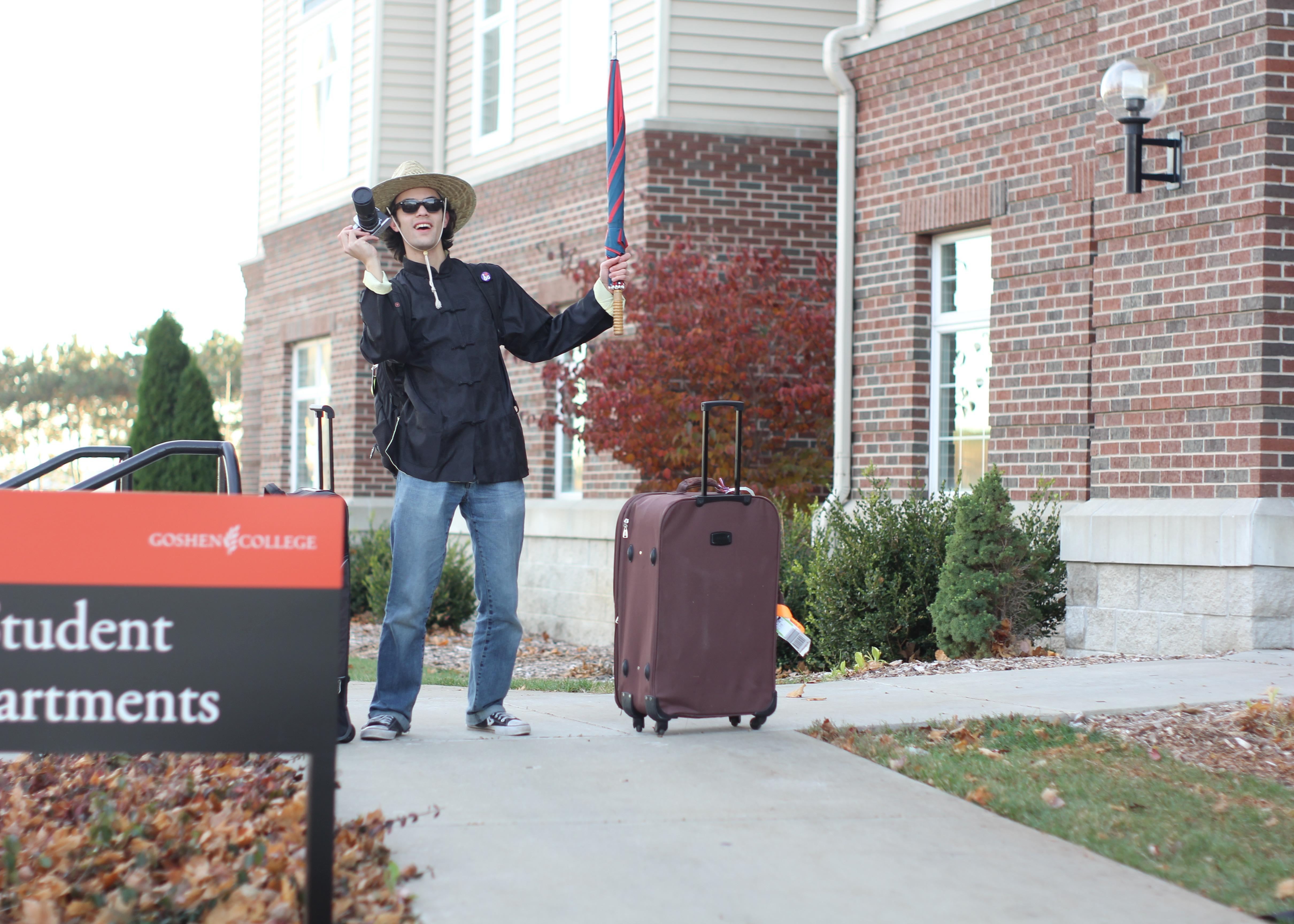 Reuben Ng prepares to leave the student apartments with his suitcase for SST