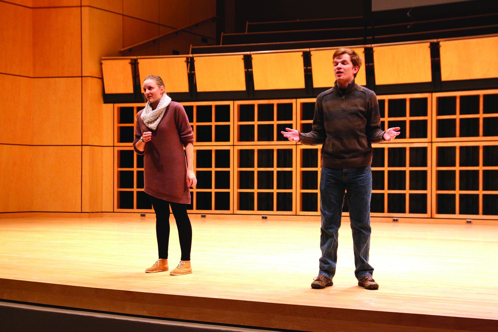 Rhianna Cockrell and Ben Ganger practice their vocals on the Sauder Concert Hall stage
