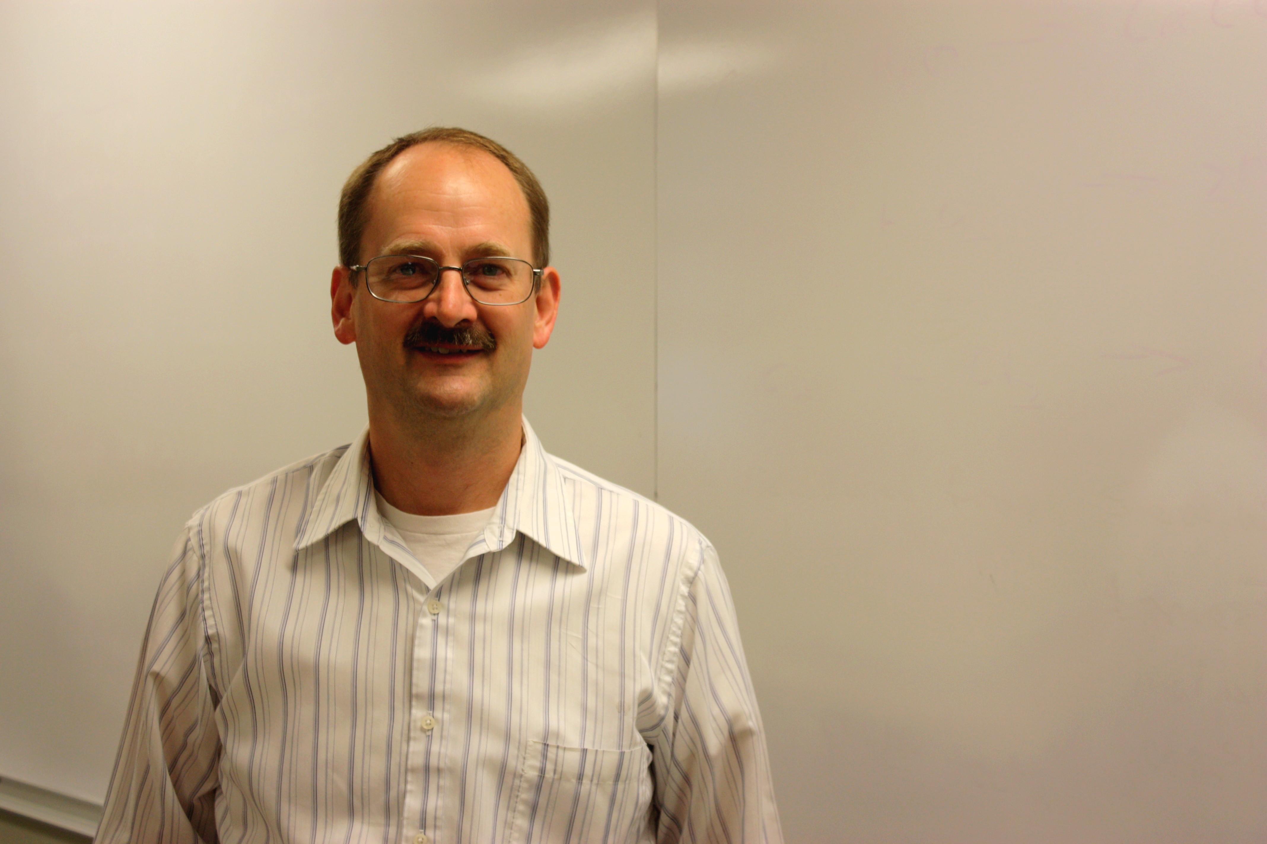 Portrait of Dan Smith in classroom