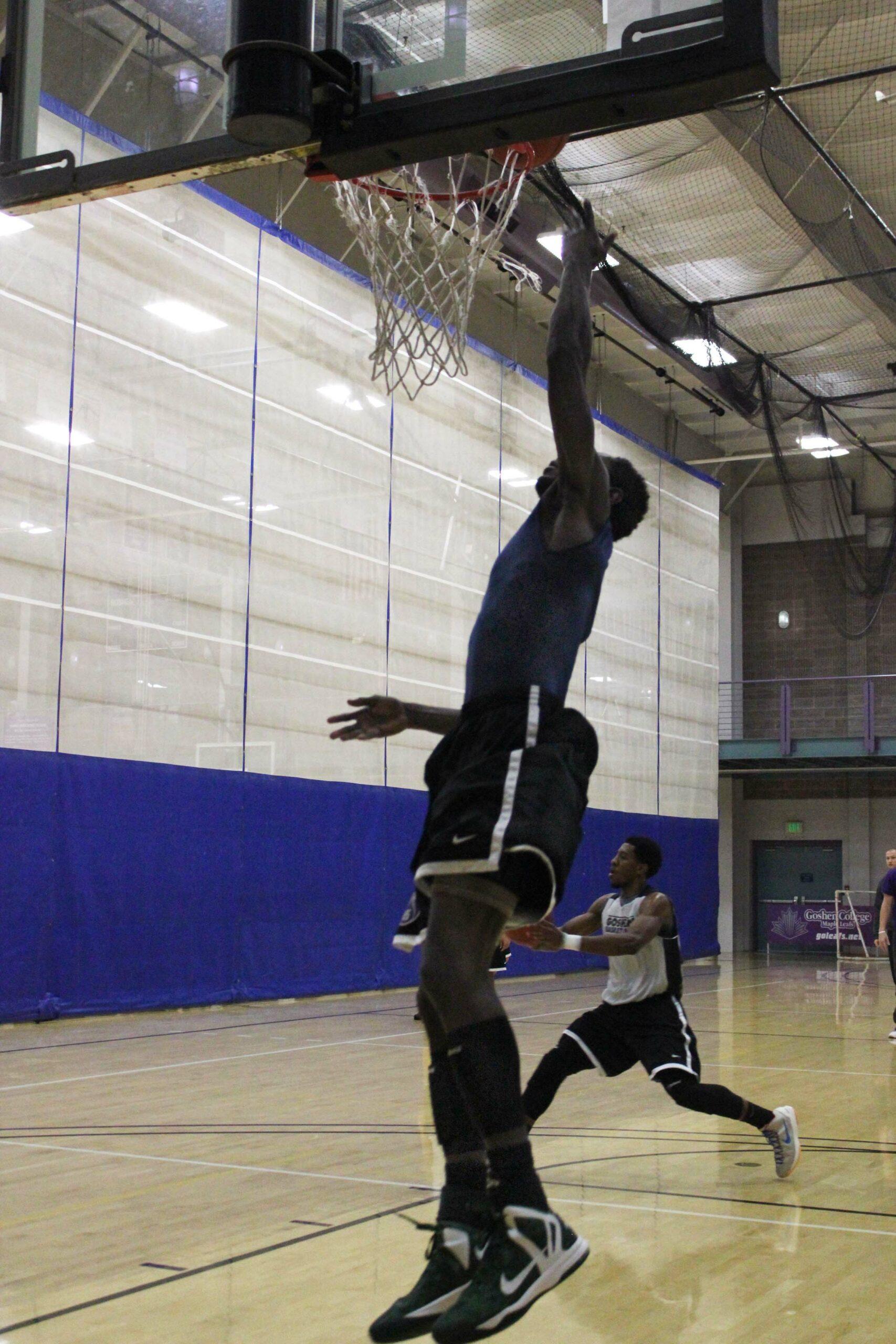Sunday Mahaja and Jerron Jamerson practice dunks in the RFC gym