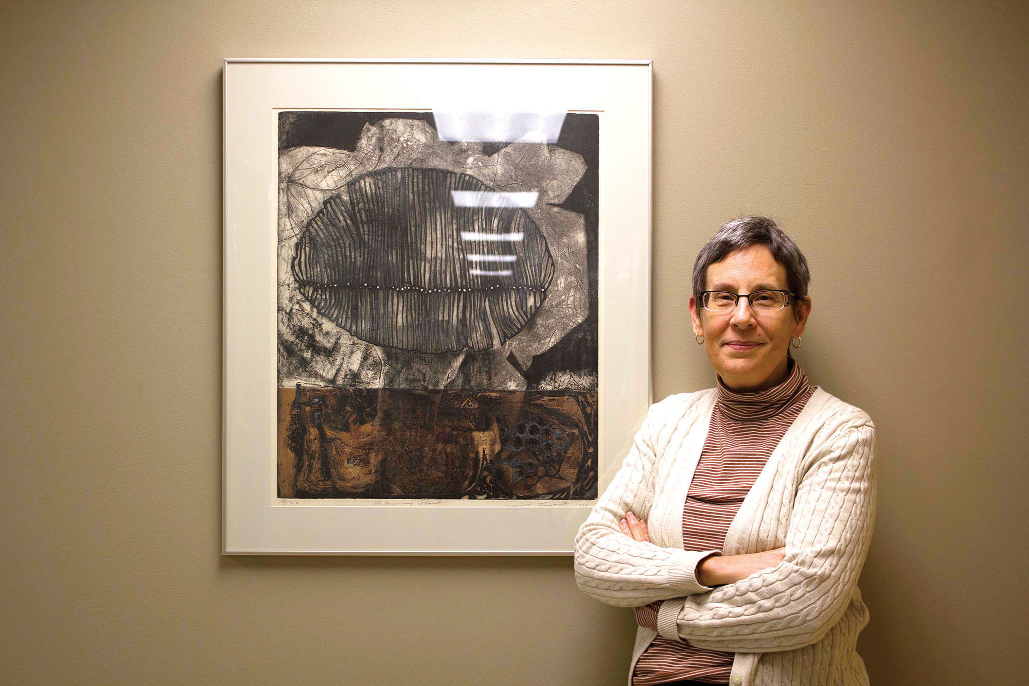 Dr. Jo-Ann Brant stands next to a painting