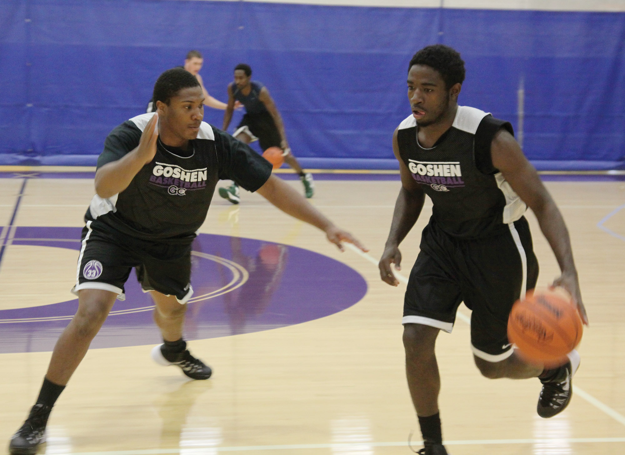 Tre Boyd and Terry Cook Jr. practice basketball in the RFC gym