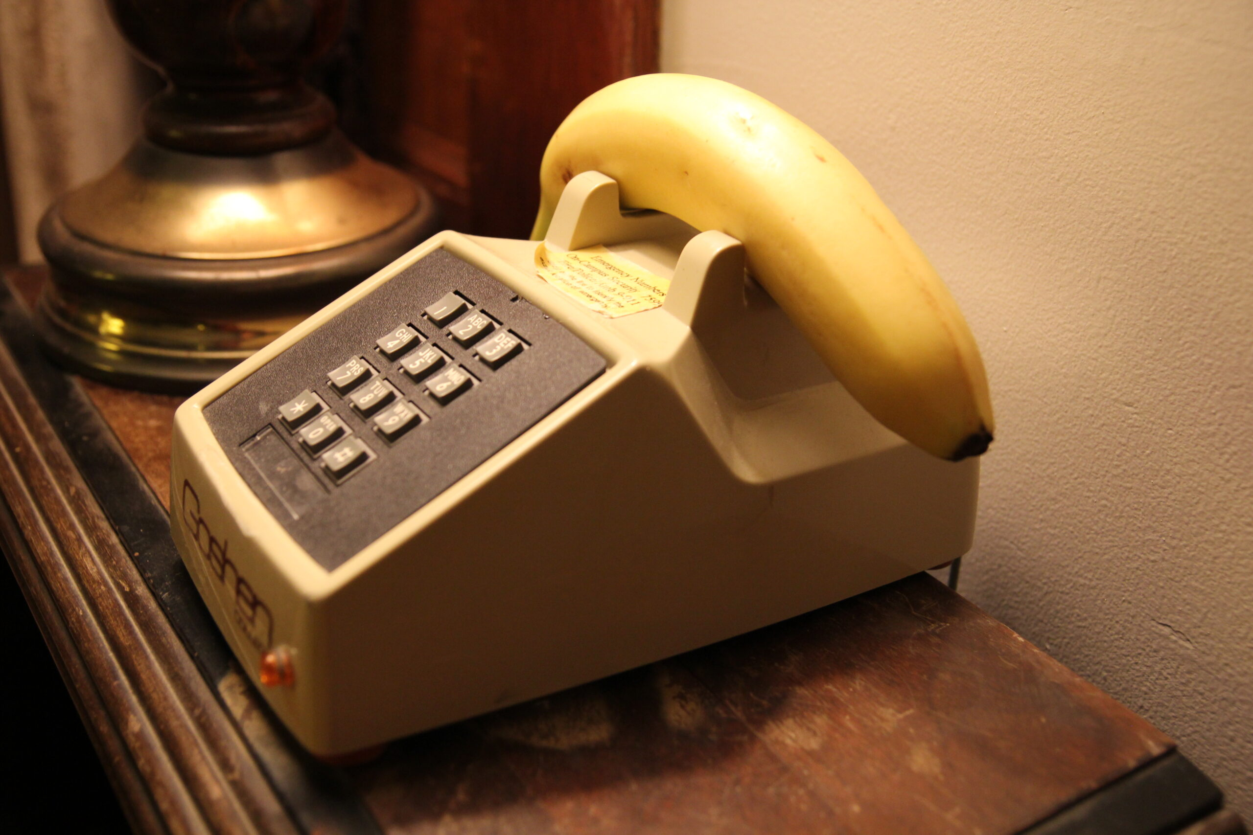A telephone stand with a banana instead of a telephone