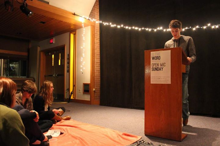 Kolton Nay reads a poem at a poetry slam in Newcomer 19