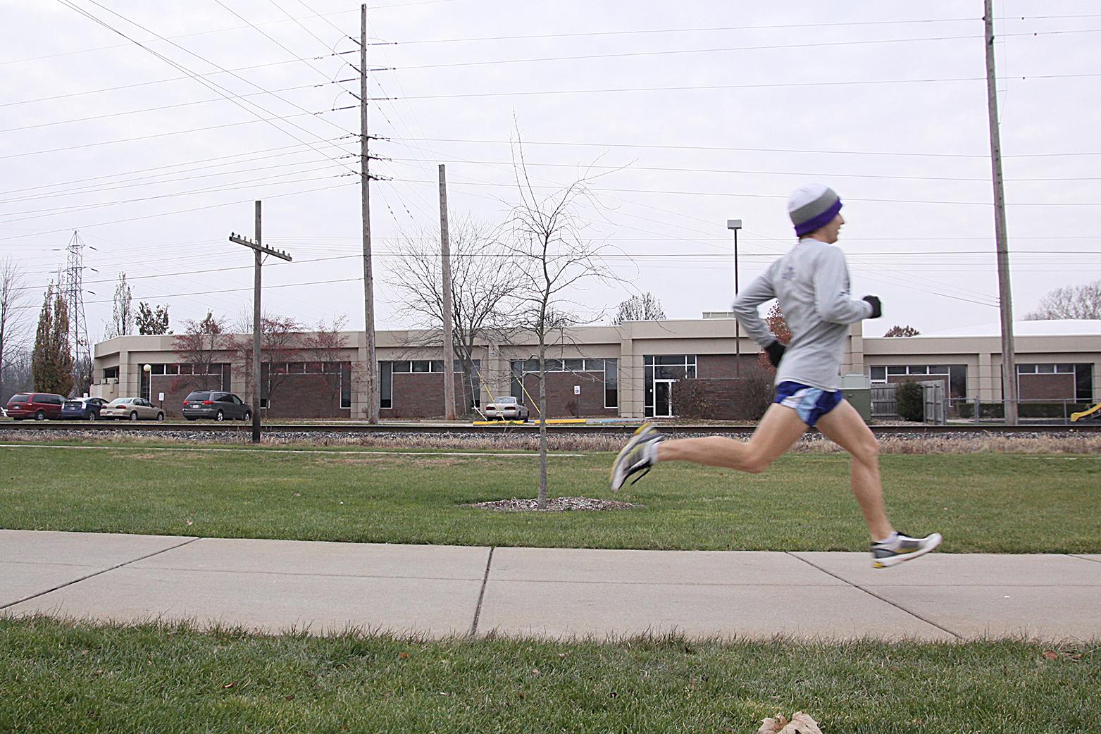 Ryan Smith runs down a path on the Goshen College campus