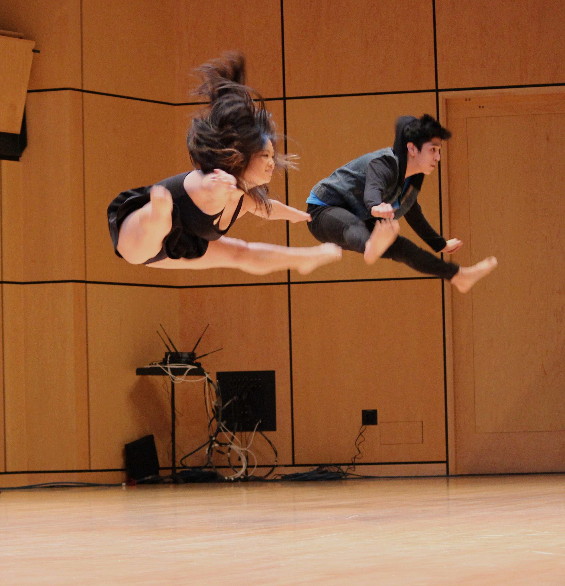 Students jump into the air doing a dance routine