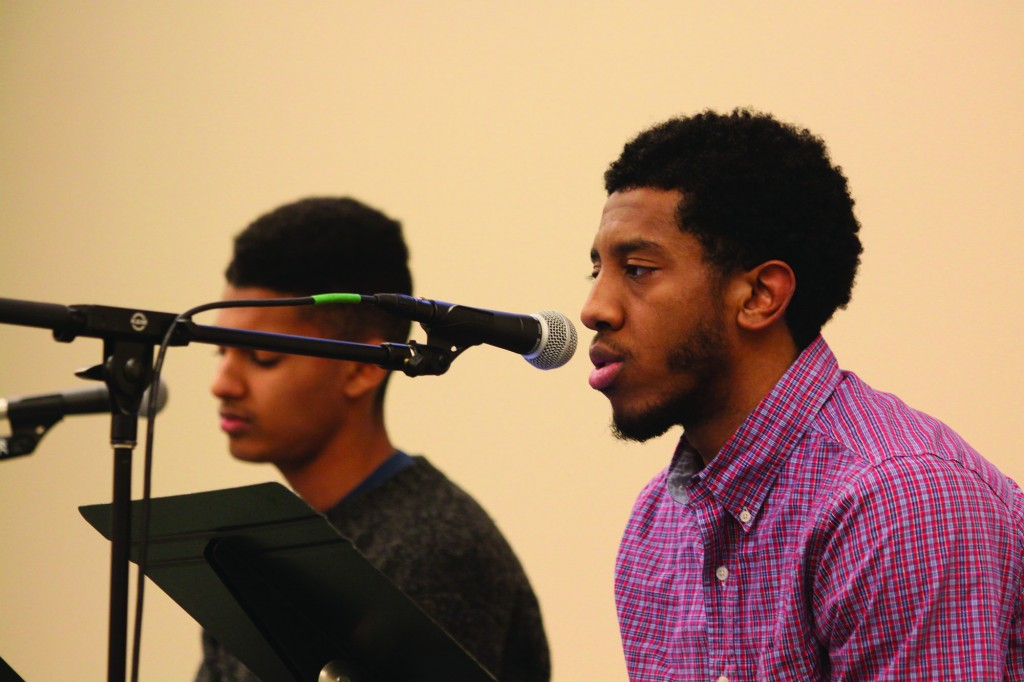 Jerron Jamerson shares a poem at the Spoken-Word Coffeehouse Monday. Photo by Isaac Fast