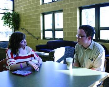 Cara Paden and Timothy Keiderling discuss their views on the hiring policy. Photo by Hannah Sauder