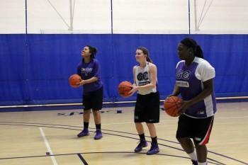 Jo'Mani Thomas, Liz Tecca, and Tyra Carver prepare to shoot hoops. Photo by Leah Stebly