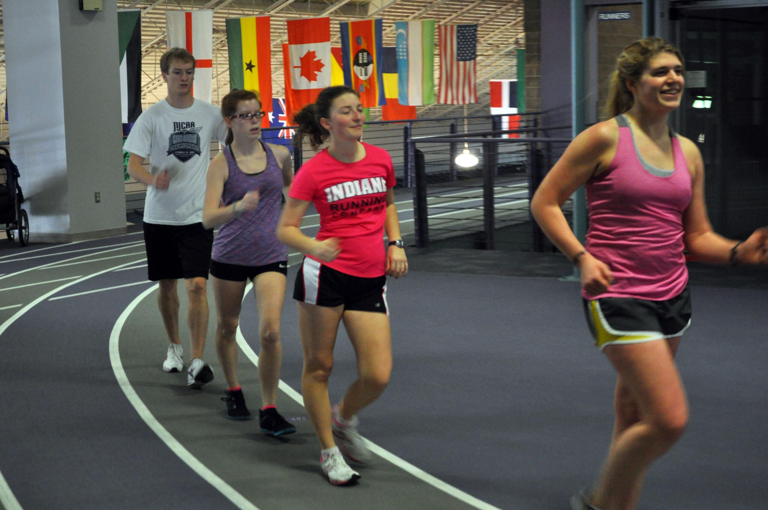 race walkers on indoor track