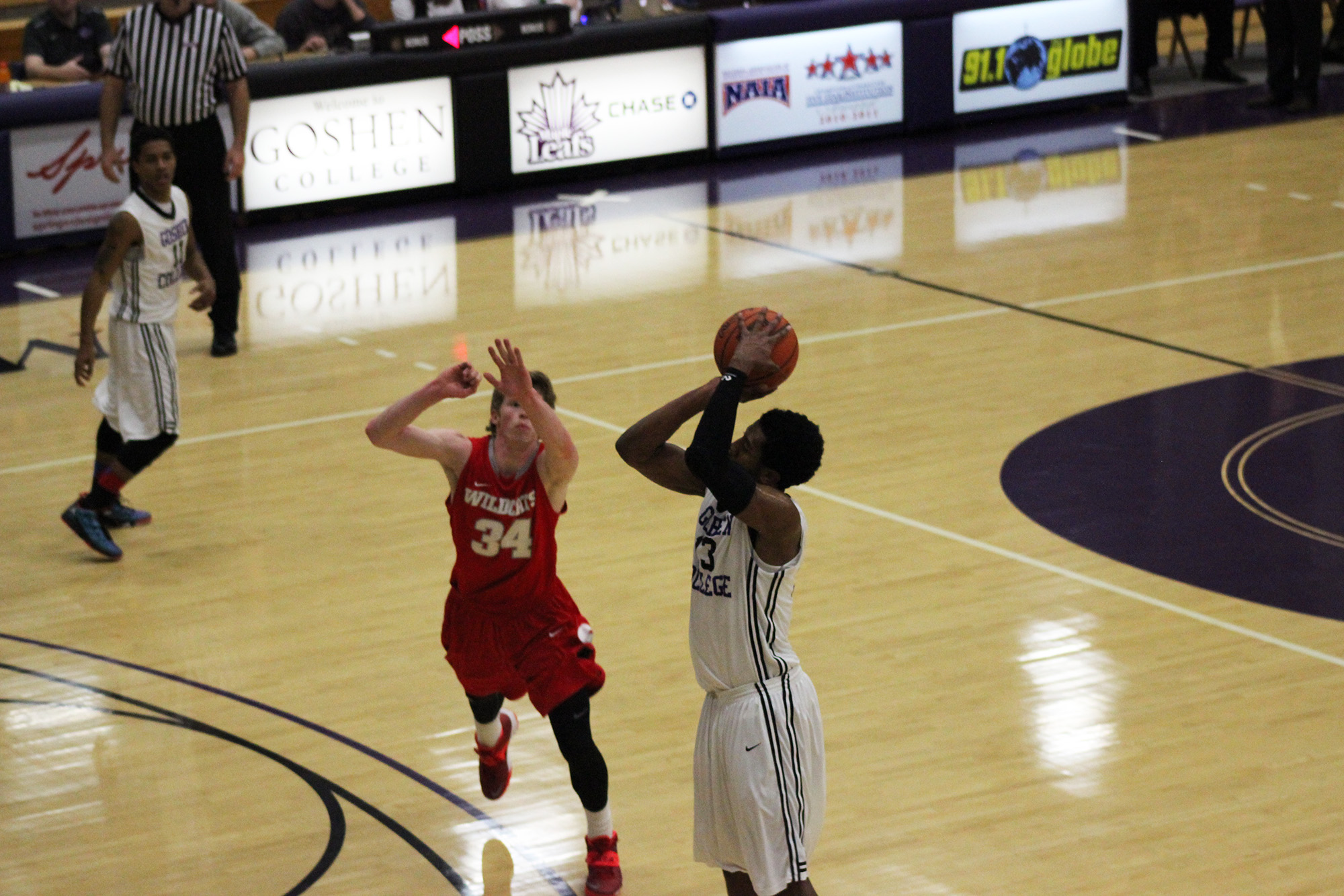 basketball player shoots the ball