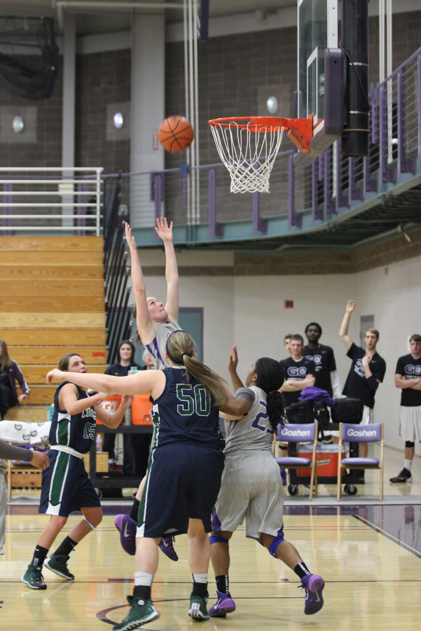 basketball players fight for rebound