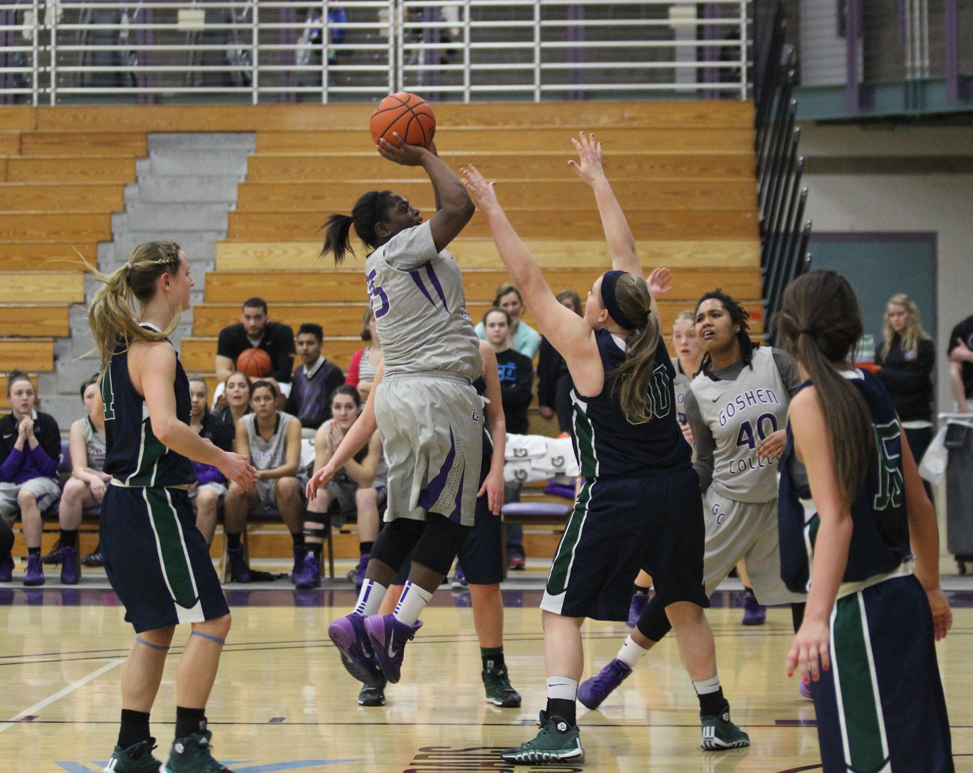 basketball player shoots ball