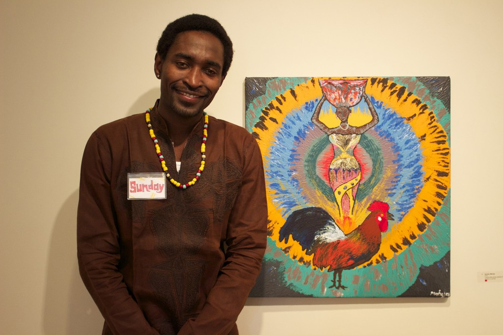 "Sunday Mahaja poses with his piece entitled ""Oya."""