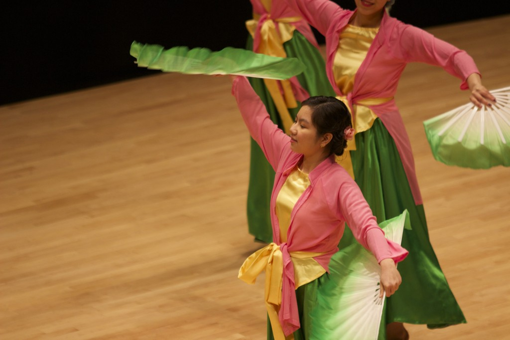 Chau Bui performs a Vietnamese dance using fans.