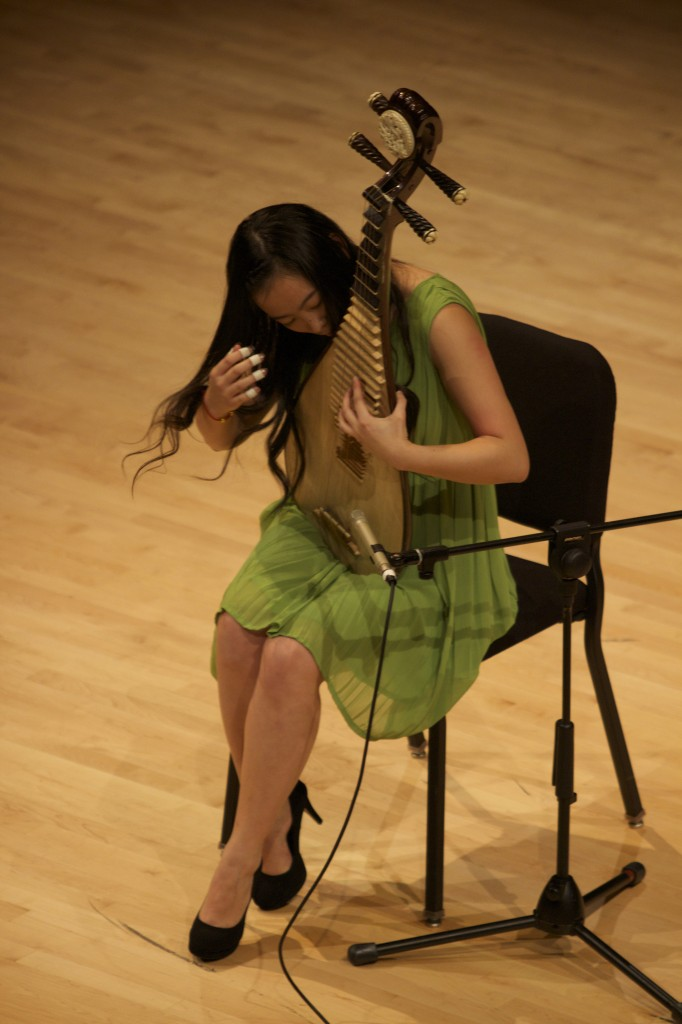 Tiantian Chen plays a traditional Chinese instrument.