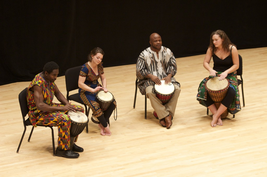 Sunday Mahaja, Maddie Ruth, Adama Millogo and Melanie Drinkwater perform African drumming.