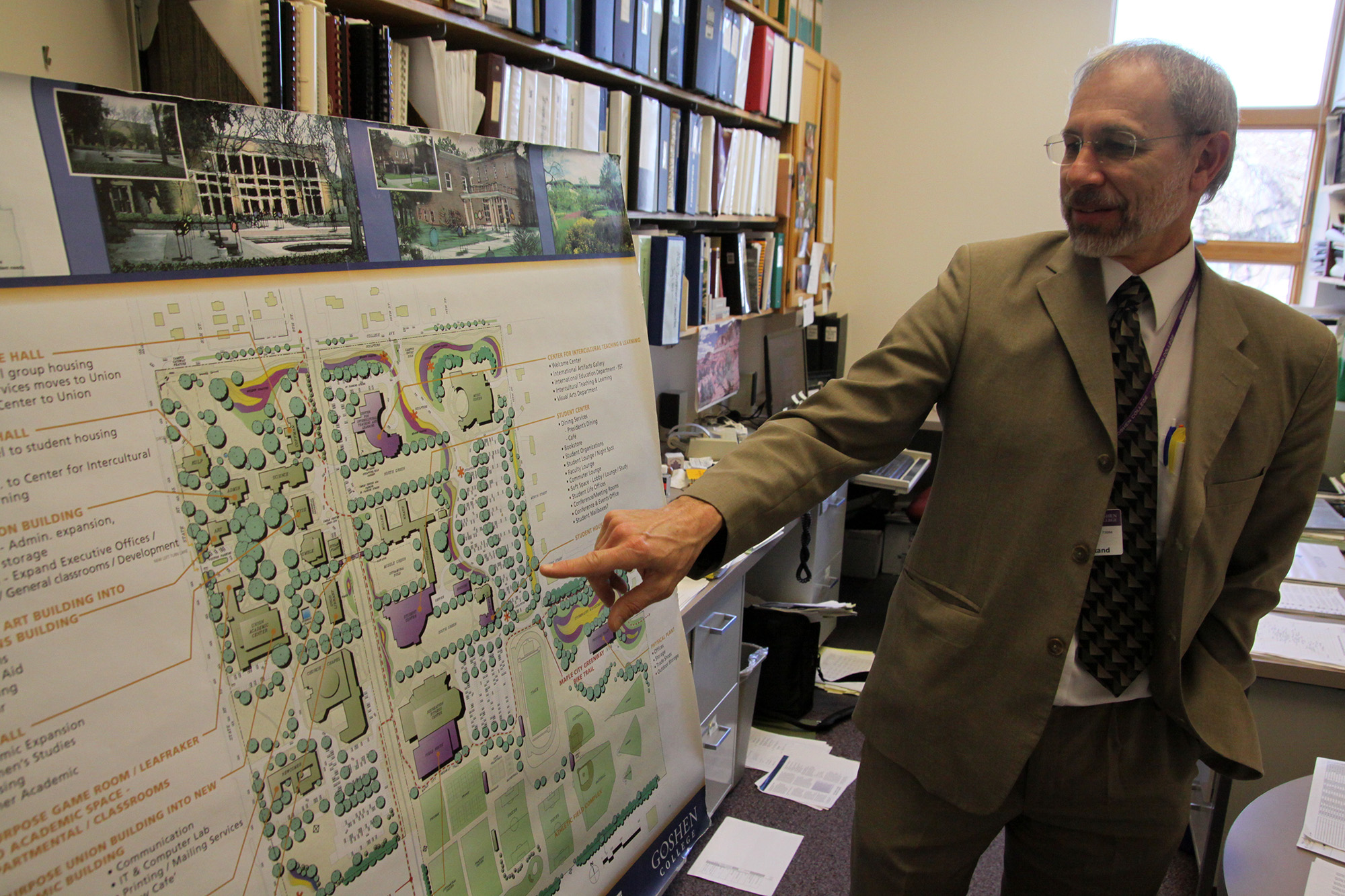 administrator points to a map of master plan