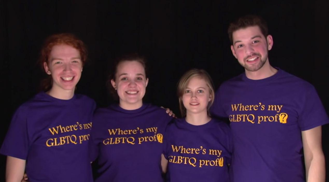 Group of students wearing purple shirts