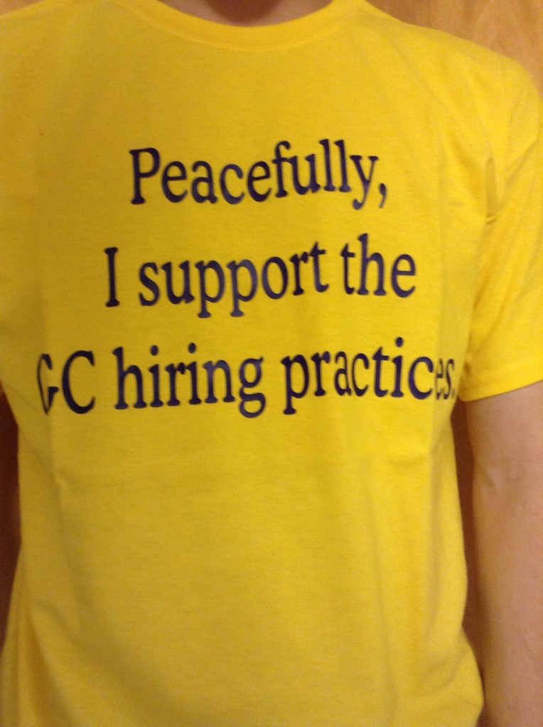Ryan Smith, a first-year, bought shirts symbolizing support for GC hiring policies.