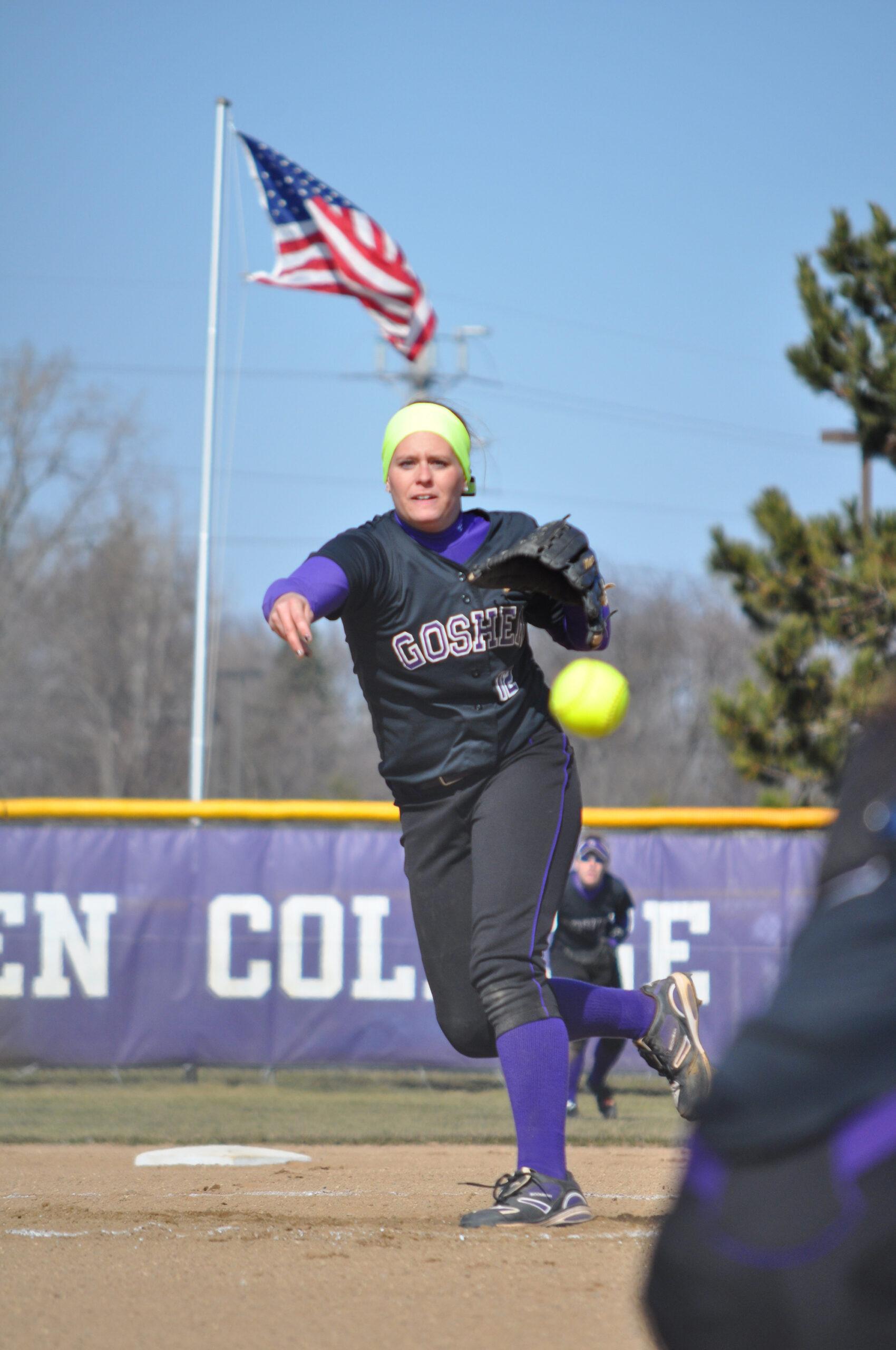 softball player pitching