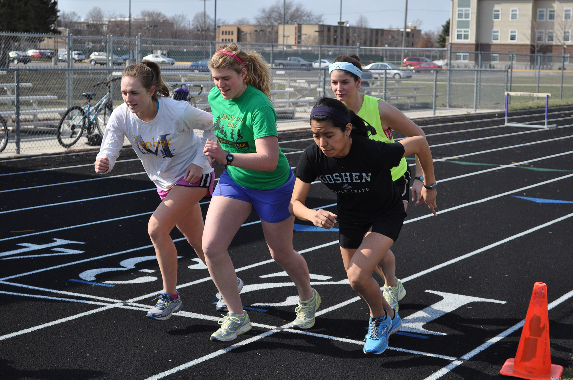 women accelerate at starting line