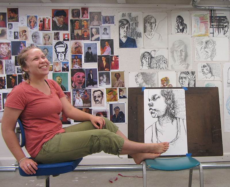 Ida posing with some of her artwork