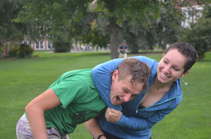 Maria Jantz puts her brother David in a friendly chokehold