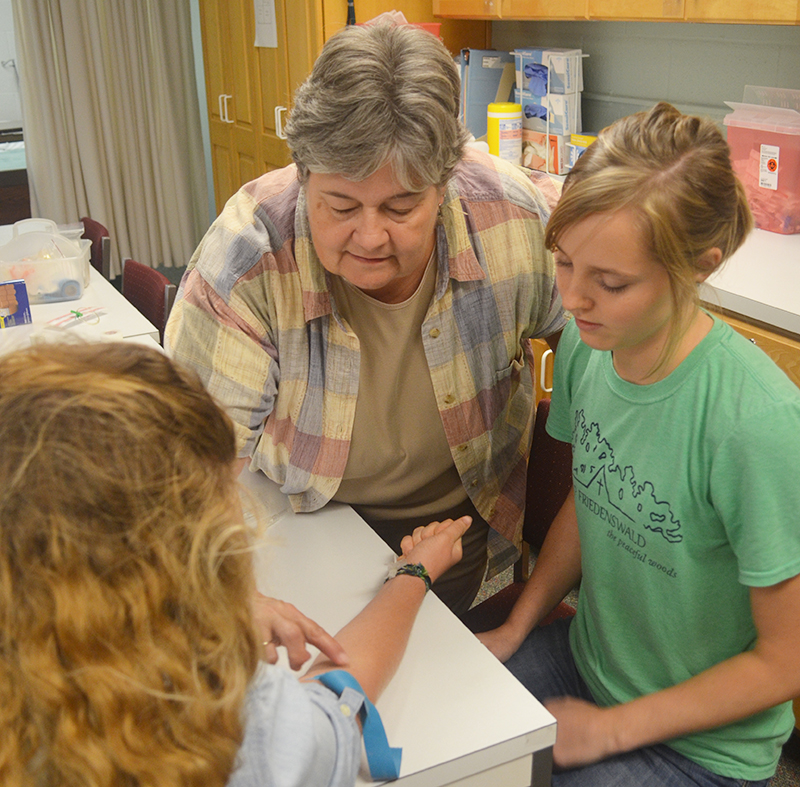 Nursing students getting hands on learning