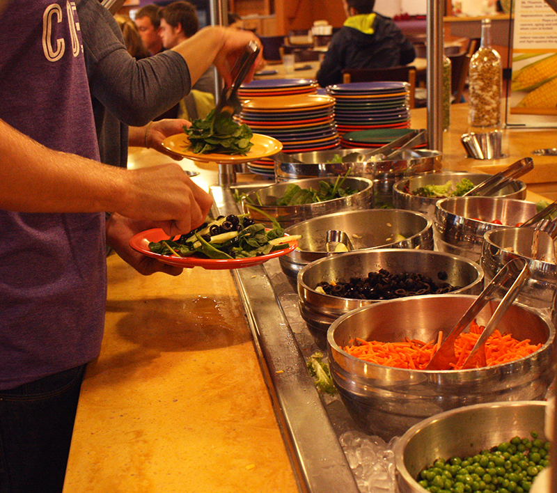 students go through salad line at dining hall